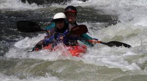Photo: Nancy and Steve paddle their Toppo Duo through Satan's Cesspool on the AouthFork of the American River