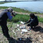 Filmaker Nancy Brink examines marine trash with guide Jeremiah Mellor.