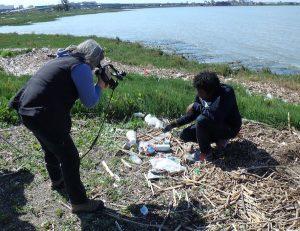 Filmaker Nancy Brink examines marine trash with guide Jeremiah Mellor.